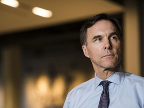 Finance Minister Bill Morneau speaks to media after meeting with private sector economists in Toronto on Friday, February 16, 2018.