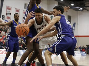 Forward Eddie Ekiyor, seen here in last Saturday's conference final against Ryerson, was one of two Carleton players named OUA first-team all-stars for this past season.