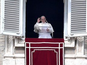 Pope Francis addresses the crowd from the window of the apostolic palace overlooking St Peter's square during the Sunday Angelus prayer, on March 4, 2018 in Vatican City.