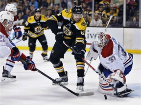 Boston Bruins' Rick Nash (61) battles Montreal Canadiens' Antti Niemi (37) for a rebound during the second period of an NHL hockey game in Boston, Saturday, March 3, 2018.