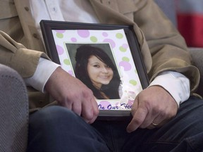 A photo of Hilary Bonnell is seen as Pam Fillier and her husband Fred Fillier appear at the National Inquiry into Missing and Murdered Indigenous Women and Girls in Moncton, N.B. on Tuesday, Feb. 13, 2018. The national inquiry looking missing and murdered Indigenous women and girls says it needs more time to finish its work.