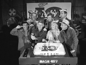 "FILE - In this Oct. 22, 1981, file photo, Jamie Farr, from front left, plugs his ears as cast members of the ""M.A.S.H."" television series cast Harry Morgan, Loretta Swit, William Christopher and, from back from left, Mike Farrell, Alan Alda and David Ogden Stiers celebrate during a party on the set of the popular CBS program in Los Angeles. Stiers a prolific actor best known for playing a surgeon on the television series ""M.A.S.H."" has died, the actor's agent Mitchell Stubbs confirmed Saturday night, March 4, 2018, in an email. He was 75."