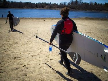 Warmer temperatures hit Ottawa Sunday April 22, 2018 and people were out and about enjoying the sunshine at Mooney's Bay Park. L-R Kevin Payan and Emma Bédard were all geared up and ready to get their boards out on the water as the warmer temperatures hit the capital this weekend.