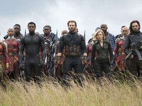 """This image released by Marvel Studios shows, front row from left, Danai Gurira, Chadwick Boseman, Chris Evans, Scarlet Johansson and Sebastian Stan in a scene from """"Avengers: Infinity War,"""" premiering on April 27."""