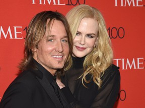 """FILE - In this April 24, 2018 file photo, Keith Urban, left, and Nicole Kidman attend the Time 100 Gala celebrating the 100 most influential people in the world in New York. On Urban's new record, """"Graffiti U,"""" Kidman added backing vocals to his single, """"Female,"""" a song that was inspired by the #MeToo movement, and Urban says she was the inspiration for at least two other songs on the album that came out April 27."""