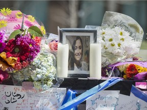 A photo of one of the van attack victims placed among flowers on Yong Street, Thursday April 26, 2018.