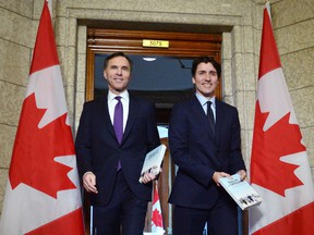 Finance Minister Bill Morneau and Prime Minister Justin Trudeau leave the prime minister's office to table the federal budget in the House of Commons in Ottawa on Tuesday, Feb.27, 2018.