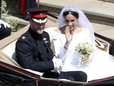 Britain's Prince Harry and Meghan Markle leave after their wedding at St. George's Chapel in Windsor Castle in Windsor, near London, England, Saturday, May 19, 2018.
