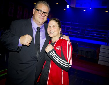 Angelo Tsarouchas, emcee for the event, and Jill Perry, Beaver Boxing Club head coach and president.