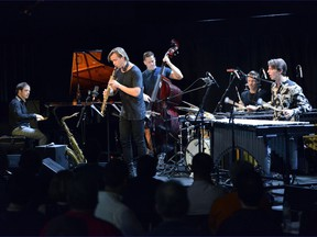Saxophonist Marius Neset at the helm of his band at the 2018 TD Ottawa Jazz Festival.