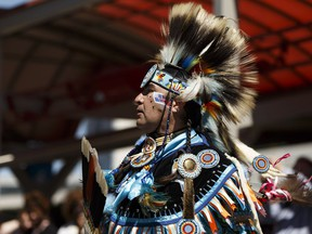 Kevin Buffalo dances during an advance celebration of National Indigenous Peoples Day in Edmonton erlier this month. (Photo by Ian Kucerak/Postmedia)