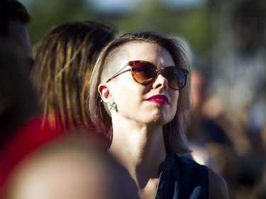A woman watches Amos the Transparent from Ottawa at the City Stage Sunday July 8, 2018, at RBC Bluesfest.