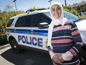 Aisha Sherazi suggests that the Ottawa police service offer regular ride-alongs to ordinary citizens as an active outreach program. (Errol McGihon/Postmedia)