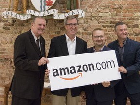 Orléans Coun. Bob Monette, Mayor Jim Watson, Cumberland Coun. Stephen Blais, and Beacon Hill-Cyrville Coun. Tim Tierney after officially announcing that Amazon will be building a large fulfillment centre in the east end of the city.