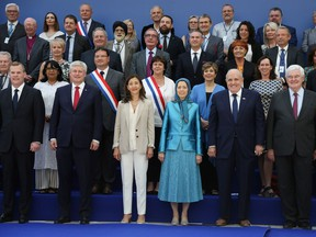 Former Canadian foreign minister John Baird and former PM Stephen Harper joined leader of the People's Mujahedin of Iran Maryam Rajavi on stage during a recent rally of the Iranian opposition in Paris. Harper has been  criticized by some for attending and speaking at the meeting.