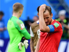 English captain Harry Kane reacts to his team's loss to Belgium at St. Petersburg on Saturday.