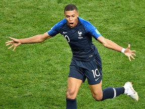 France forward Kylian Mbappe celebrates after scoring a goal during the Russia 2018 World Cup final football match between France and Croatia at the Luzhniki Stadium in Moscow on July 15, 2018.