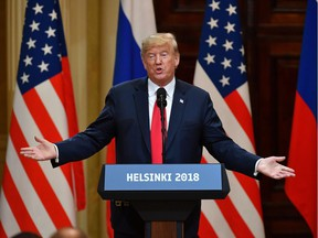 """US President Donald Trump speaks during a joint press conference with Russia's President after a meeting at the Presidential Palace in Helsinki, on July 16, 2018. The US and Russian leaders opened an historic summit in Helsinki, with Donald Trump promising an """"extraordinary relationship"""" and Vladimir Putin saying it was high time to thrash out disputes around the world."""