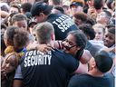 Security helps a woman out of the crushing huge crowd during last years Bluesfest.