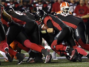 The Redblacks' Trevor Harris (7) attempts a quarterback sneak during the first half of Friday's game against the Lions.