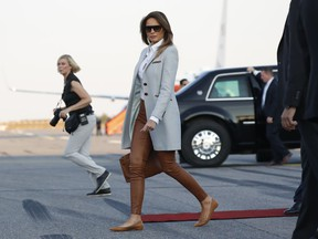 Melanie Trump walks to the car after she arrived with U.S. President Donald Trump at the airport in Helsinki, Finland, Sunday, July 15, 2018 on the eve of his meeting with Russian President Vladimir Putin.