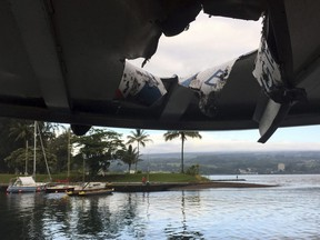 This photo provided by the Hawaii Department of Land and Natural Resources shows damage to the roof of a tour boat after an explosion sent lava flying through the roof off the Big Island of Hawaii Monday, July 16, 2018, injuring at least 23 people.