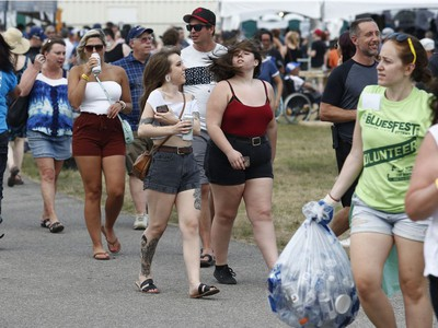 Music fans during opening night at the Ottawa Bluesfest in Ottawa Thursday July 5, 2018. Some fans cooled off inside the War Museum Thursday.  Tony Caldwell