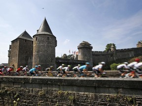 The pack leaves Fougeres, rear, during the seventh stage of the Tour de France cycling race over 231 kilometers (143.5 miles) with start in Fougeres and finish in Chartres, France, France, Friday, July 13, 2018.