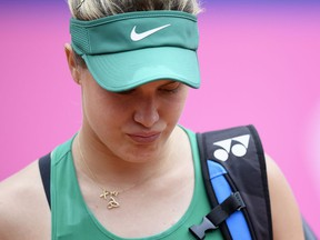 Eugenie Bouchard of Canada leaves the court after giving up during the semi-final game against Alize Cornet of France at the WTA Ladies Championship tennis tournament in Gstaad, Switzerland, Saturday, July 21, 2018.