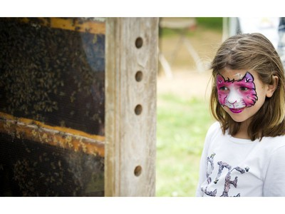The Canada Agriculture and Food Museum held a day of activities for the whole family to celebrate World Honeybee Day Saturday August 18, 2018. five-year-old Melody Barrie takes a close look at the bees.