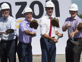 Prime Minister Justin Trudeau, second right, Ottawa Mayor Jim Watson, left, Amazon Ddrector of operations Canada Glenn Sommerville, second left, and vice president of Amazon Canada Alexandre Gagnon, right, participate in the ground breaking ceremony.