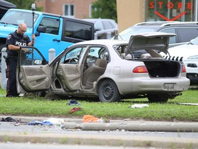 Police investigate a car crash on Princess Street in Kingston, Ont. on Tuesday, Aug. 21, 2018.  Elliot Ferguson/The Whig-Standard
