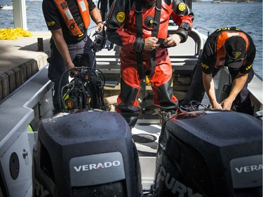 The OPP were on the St. Lawrence near Rockport Sunday September 2, 2018, searching for an 11-year-old Ottawa boy after a boat capsized Saturday afternoon. The OPP's Underwater Search and Recovery Unit suits up to do a dive down to the sunken boat.