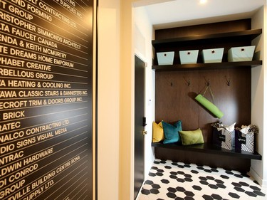 The mudroom shows one of several examples throughout the home of both thoughtful storage and geometric patterns.