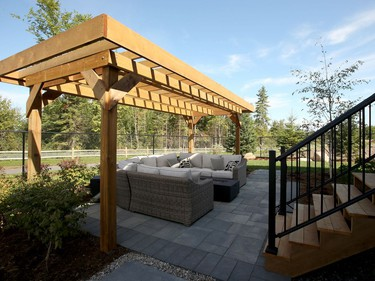 The fully landscaped backyard takes advantage of the fact the home backs onto the Feedmill Creek conservation area, with a generous deck off the main floor and a lower sitting area softened with a pergola. Julie Oliver/Postmedia