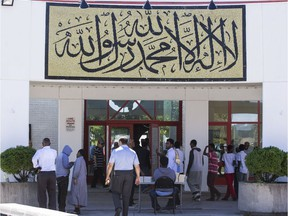 People arrive for Friday prayer at the Assalam Mosque at The Ottawa Islamic Centre.