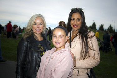 Sarah Grand, a Can't Dim My Light committee member, MJ Naim Brown and her daughter 12-year-old Mathilda-Jolie Brown.