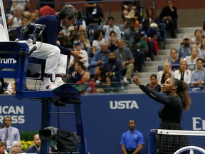 """Serena Williams of the US argues with chair umpire Carlos Ramos while playing Naomi Osaka of Japan during their 2018 US Open women's singles final match on September 8, 2018 in New York. - Osaka, 20, triumphed 6-2, 6-4 in the match marred by Williams's second set outburst, the American enraged by umpire Carlos Ramos's warning for receiving coaching from her box. She tearfully accused him of being a """"thief"""" and demanded an apology from the official."""
