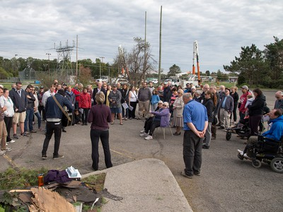 Pastor Mike Hogeboom adresses his congregation outside Arlington Woods First Methodist Church on Sunday morning as residents in Ottawa's Arlington Woods neighbourhood deal with the aftermath of the twister that touched down on Friday afternoon.