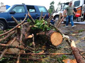 Les Sadler leaves with everything he could retrieve from his recently restored truck that was severely damaged by a tornado in the Woodvale Green area of Ottawa.