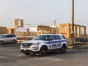 Ottawa Police at the scene of a Barrhaven construction site near Freshwater Way where a 17-year-old boy died Monday night. October 9, 2018.