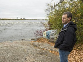 Roland Paris walks along the portage trail at Little Chaudière Rapids on the Quebec side of the Ottawa River.