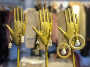 Gold-plated earrings with semiprecious stones, designed and made by Ottawa's FRUG. $30-42.