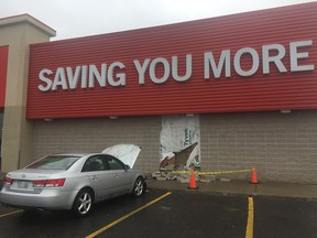 Vehicle drove into The Brick at 565 West Hunt Club Rd Friday morning.