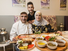 Issam Aoude with his wife Mayssaa Chaltaf and son Karim Aoude at their Semsem restaurant. August 16, 2018. Errol McGihon/Postmedia