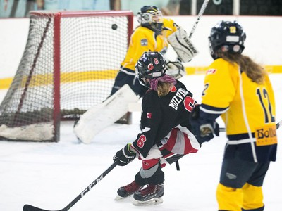 Jordan Mulvihill of the Nepean Wildcats in the Girls Atom AA division scores a goal against the Whitby Wolves as the annual Bell Capital Cup hockey tournament for Peewee and Atom level players gets underway at the Bell Sensplex and various arenas across the city.
