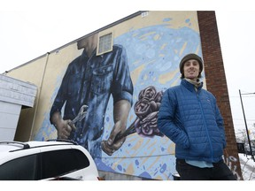 Ryan Smeeton poses by his mural at 1089 Somerset St. in Ottawa Thursday Dec 13, 2018.  Tony Caldwell