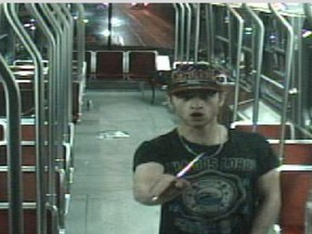 Sammy Yatim holds a knife while on a streetcar in Toronto on July 26, 2013 in this still taken from court handout surveillance video.