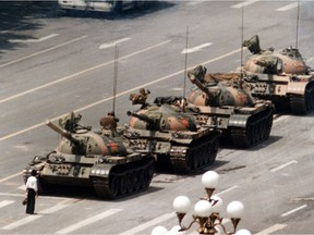 In this iconic June 5, 1989 file photo, a Chinese man stands alone to block a line of tanks heading east on Beijing's Cangan Boulevard in Tiananmen Square.  The pro-democracy protests in the square were squashed by the Chinese government.