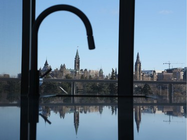 The kitchen faucet in the model suite at Zibi frames the Peace Tower, emphasizing the exceptional views the project commands.